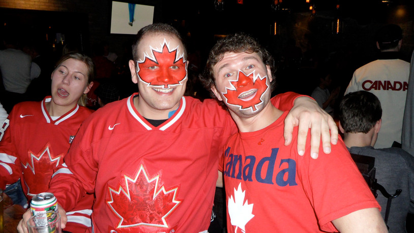 Some very patriotic fans cheering for Team Canada during the 2010 Vancouver Olympics