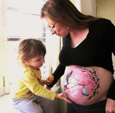 Angela and her daughter awaiting the stork's next delivery #bellypainting