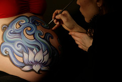 Quiet moments during a belly painting session