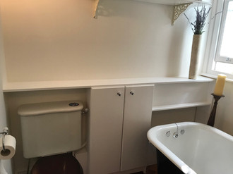 Custom cabinet and shelf to hide plumbing