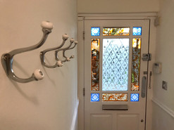 Coat hook installation and painting of entrance