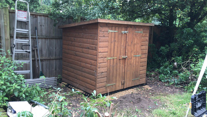 Relocated shed and installed shed base