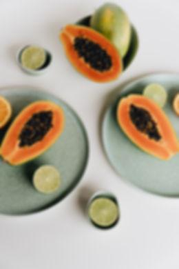 photo-of-sliced-papaya-beside-sliced-lim