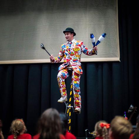 Unicycling juggling Suzuki Violin performance
