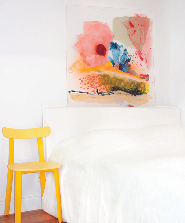 bedroom with painting on acrylic glass