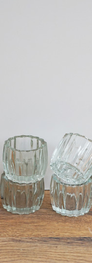 Cut glass tealight holders.