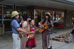Nina with Ettore, Ida, and Bobbie from Josephella singing outside Over Gatlinburg