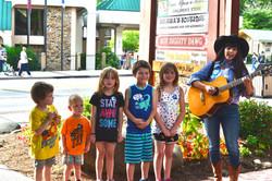 Nina with children enjoying the music in Elks Plaza (Gatlinburg)