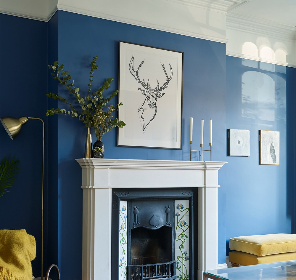 Art hanging on a blue wall