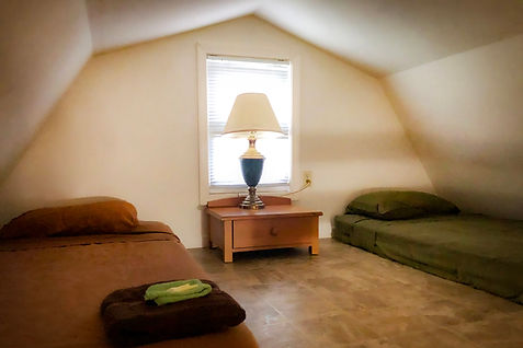 Cabin loft with two twin beds..