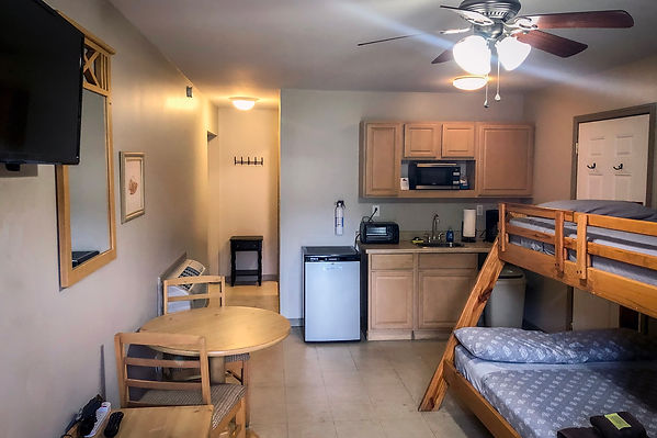 Efficiency suite with bunkbed, table, chairs, kitchenette.