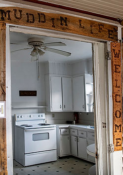 Entryway to the Sowers House kitchen with Welcome sign.