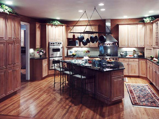 Kitchen design with overhanging pot rack and custom island.