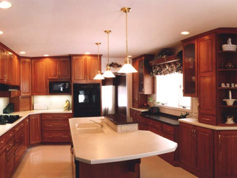 Large island in a completely renovated kitchen space.