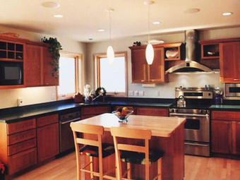 Complete kitchen replacement with black countertops.
