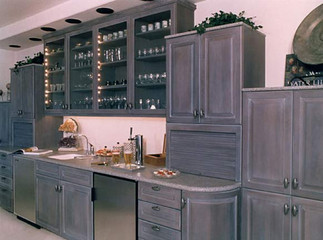 Unique gray cabinetry with custom cabinets.