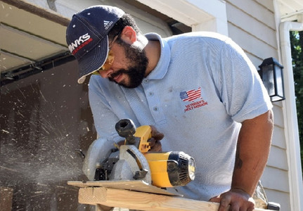 Scotty Lett working with a saw.