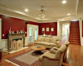 Merrimac Living Room Bob Designed & Built. Burgandy walls, with traditional furniture and a staircase.