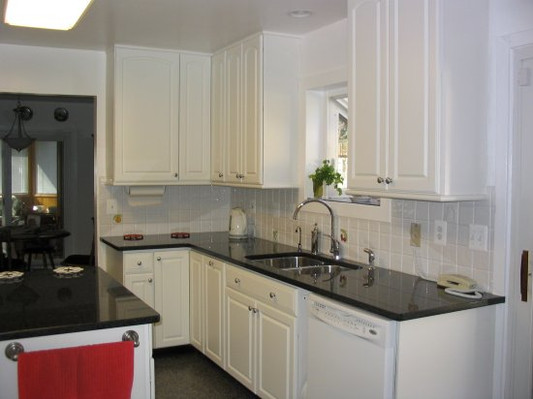 white cabinetry with dark countertops.