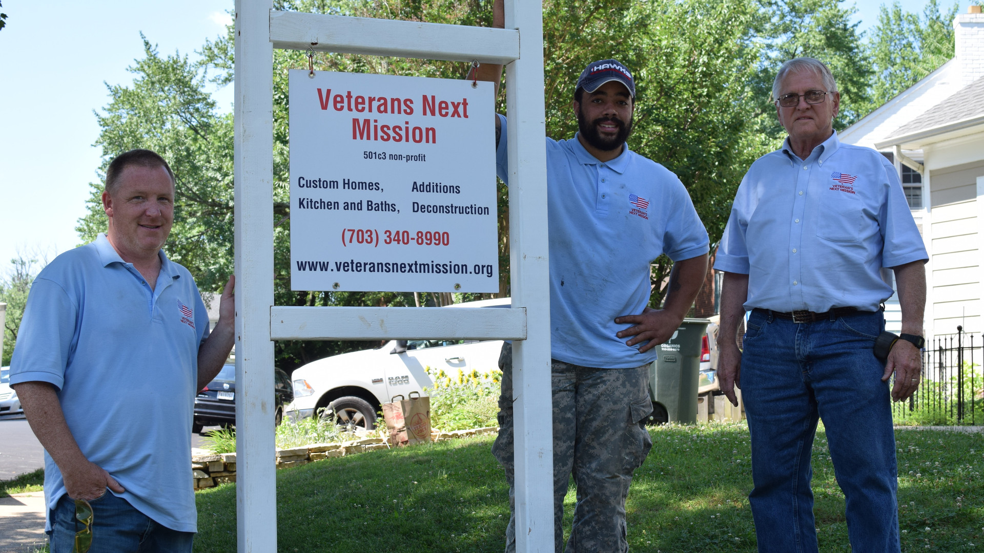 VNM crew next to a Veteran's Next Mission sign.