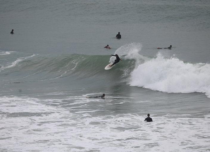Surfing at Sandy Bay
