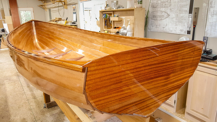 Transom ready for clear coat (varnish). It's remarkable how shiny the epoxy is--looks pretty good on its own. The clear coat will add gloss and provide UV protection.