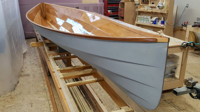 Gunwales tuned, sanded, and epoxy coated.