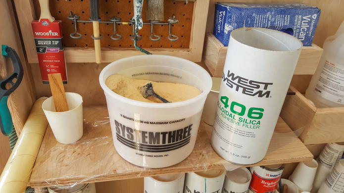 Thickening epoxy with colodial silica and wood flour mix.