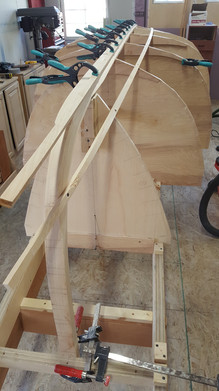 Temporary stringers used to form plank pattern and define rolling bevel on keelson.