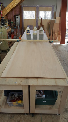 Scarfing plywood sheets to full length for planking stock.