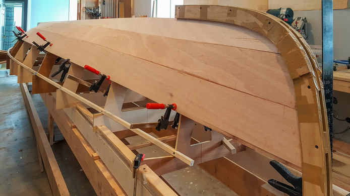 034 - Third plank glued and clamped.jpg