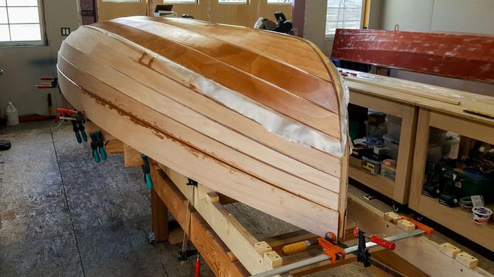 Fully planked with fiberglass skirt.