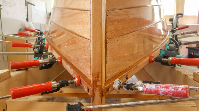 Gluing the gunwales (outwales) into place.