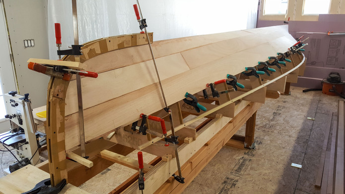 Third pair of planks glued in place.