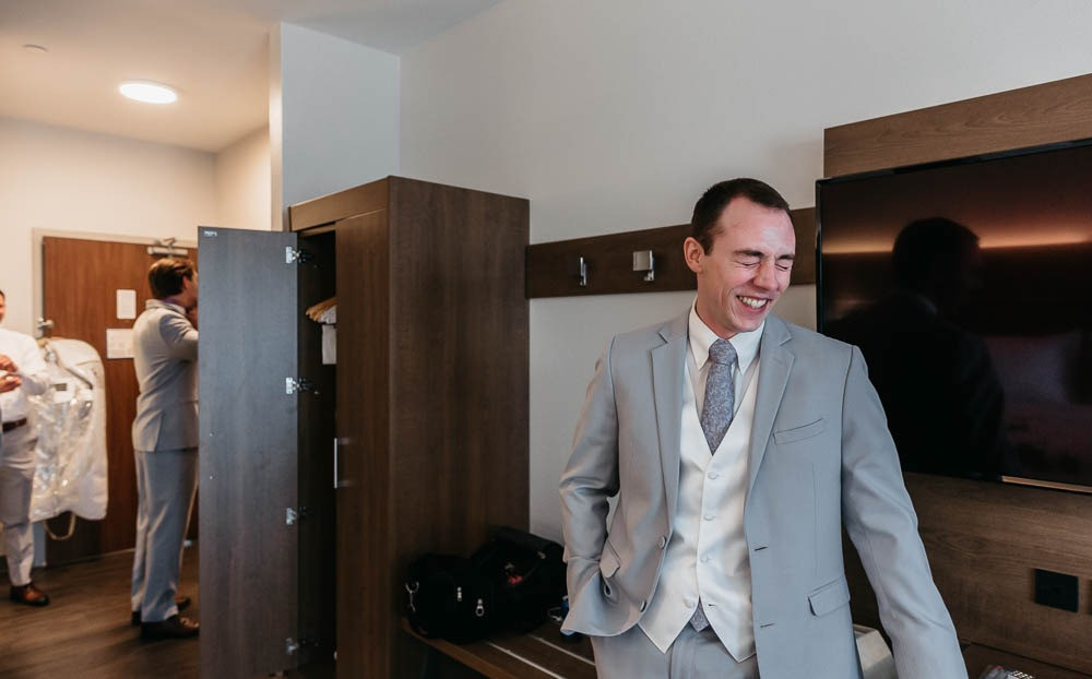 Candid photo of a groom getting ready in St. Louis