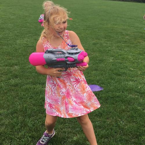 Girl holding toy gun.jpg