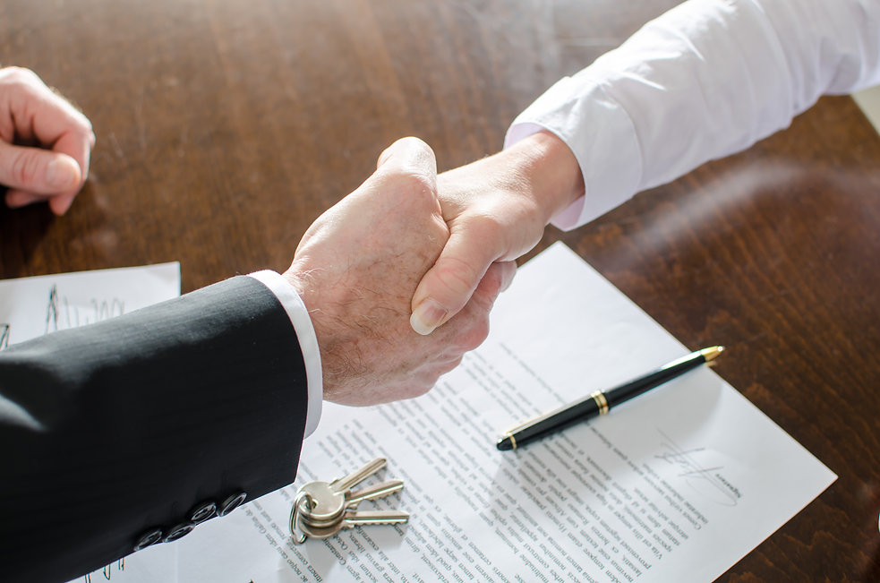 Estate agent shaking hands with his cust