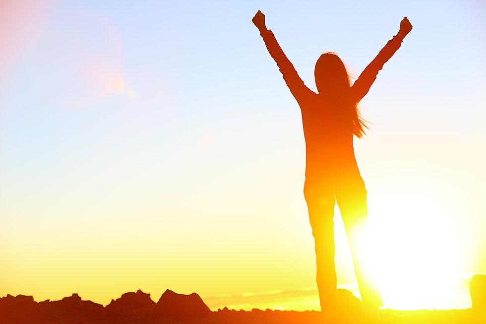 Happy celebrating winning success woman