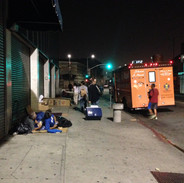 serving to people on the pavement and tr