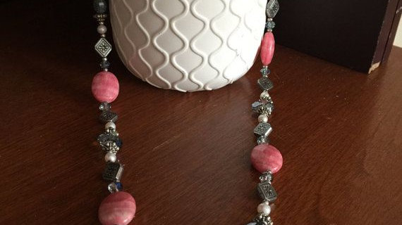 silver tone necklace made with rose jasper,crystals , and toggle clasp.�