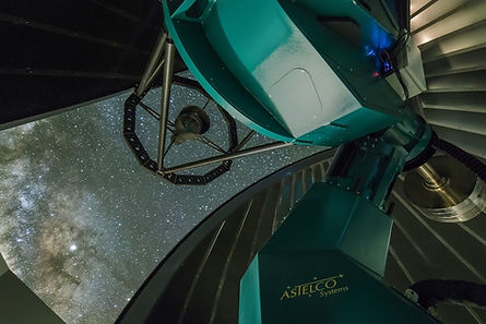 Figure 3, a view of the telescope looking up at the stars through the open roof