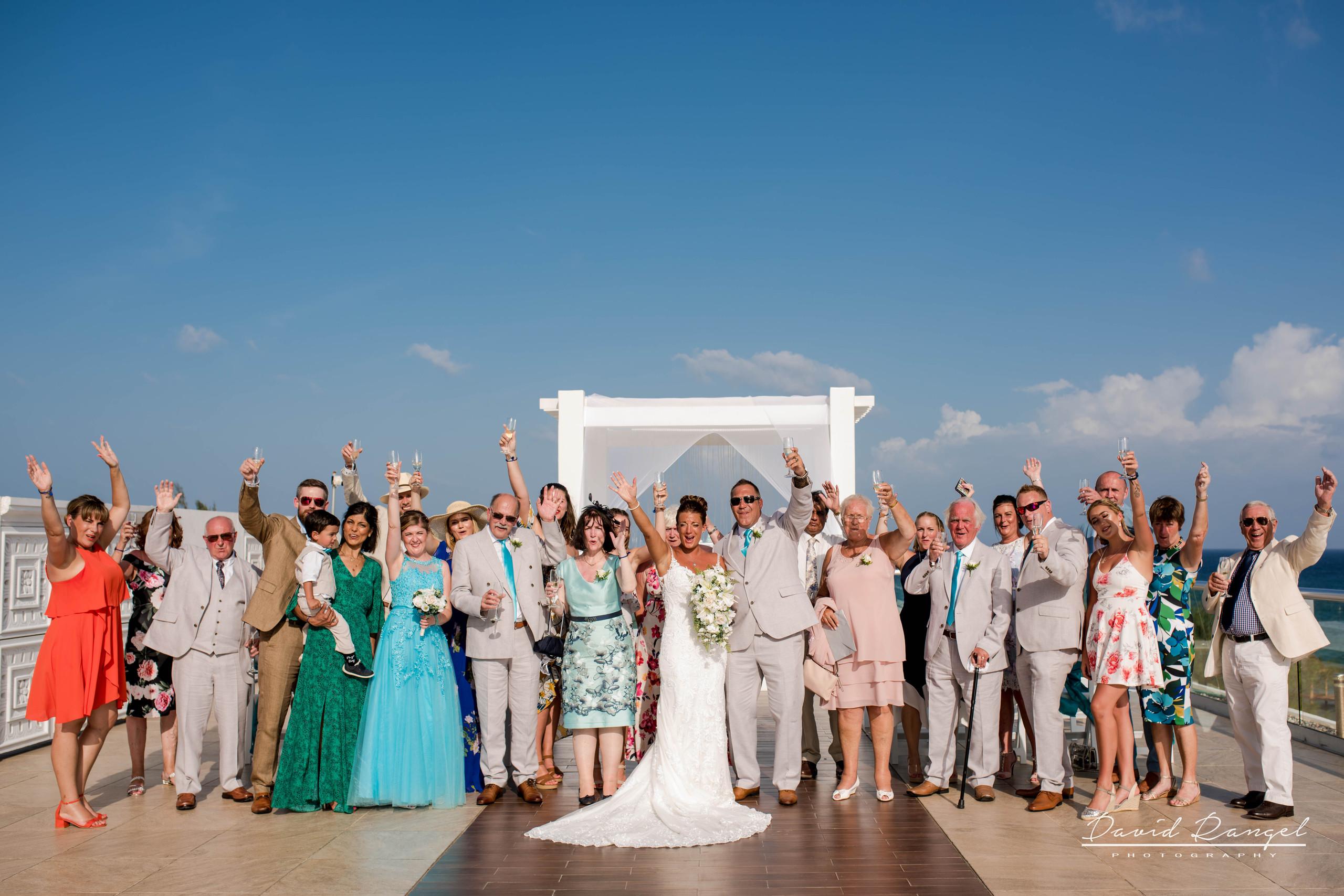 destination+wedding+group+photo+sky+terrace+deck