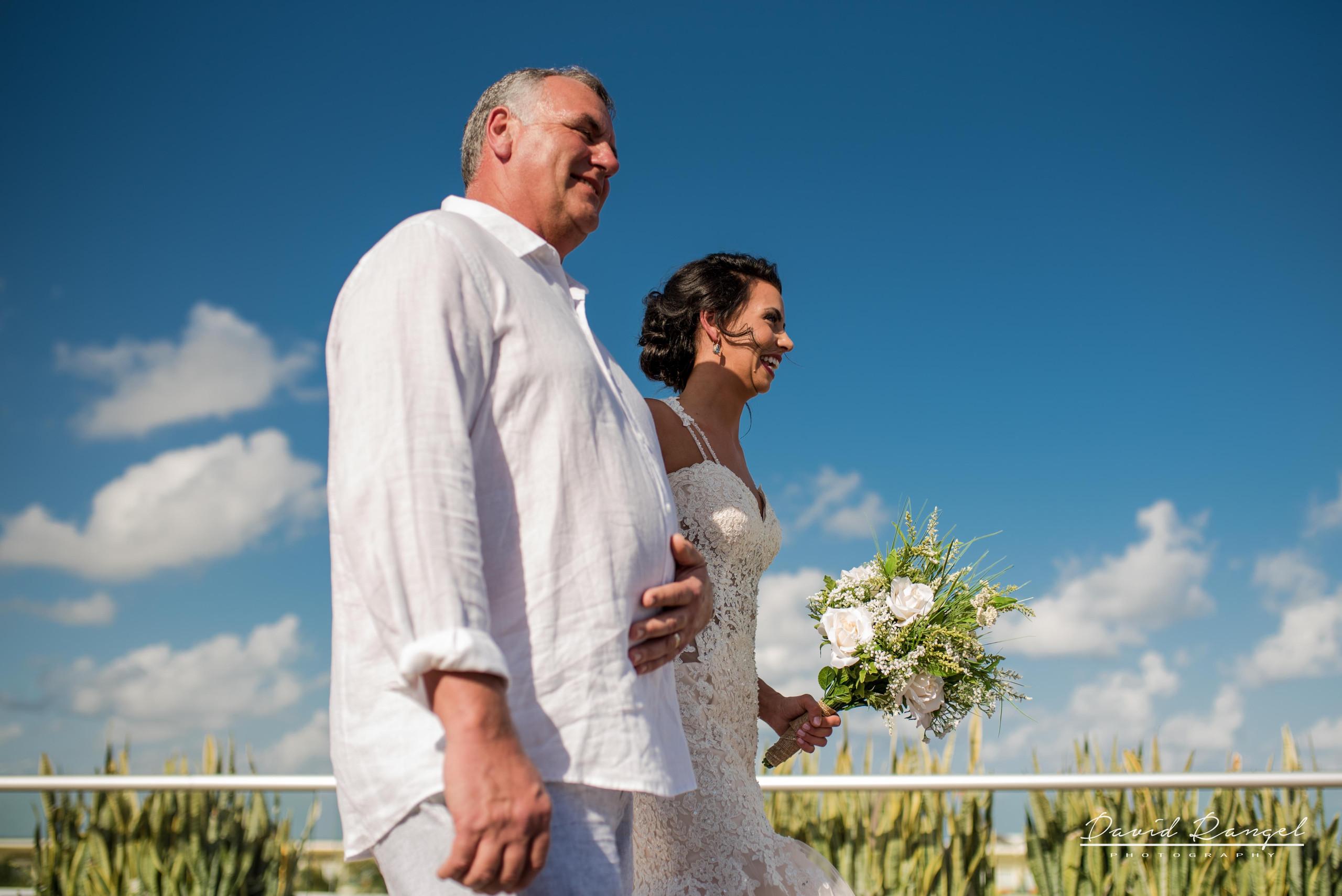 bride+walk+aisle+sky+deck+terrace+azul+beach+resort+photo