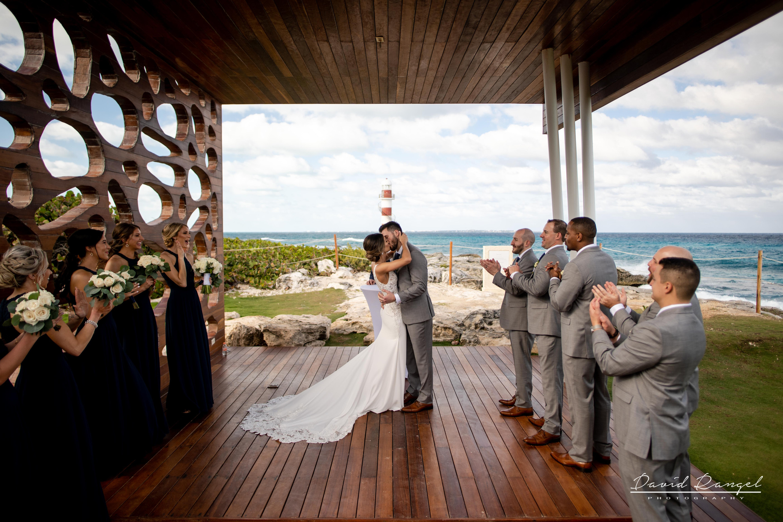 kiss+bride+groom+ceremony+happy+lighthouse+gazebo+wedding+ceremony+photo