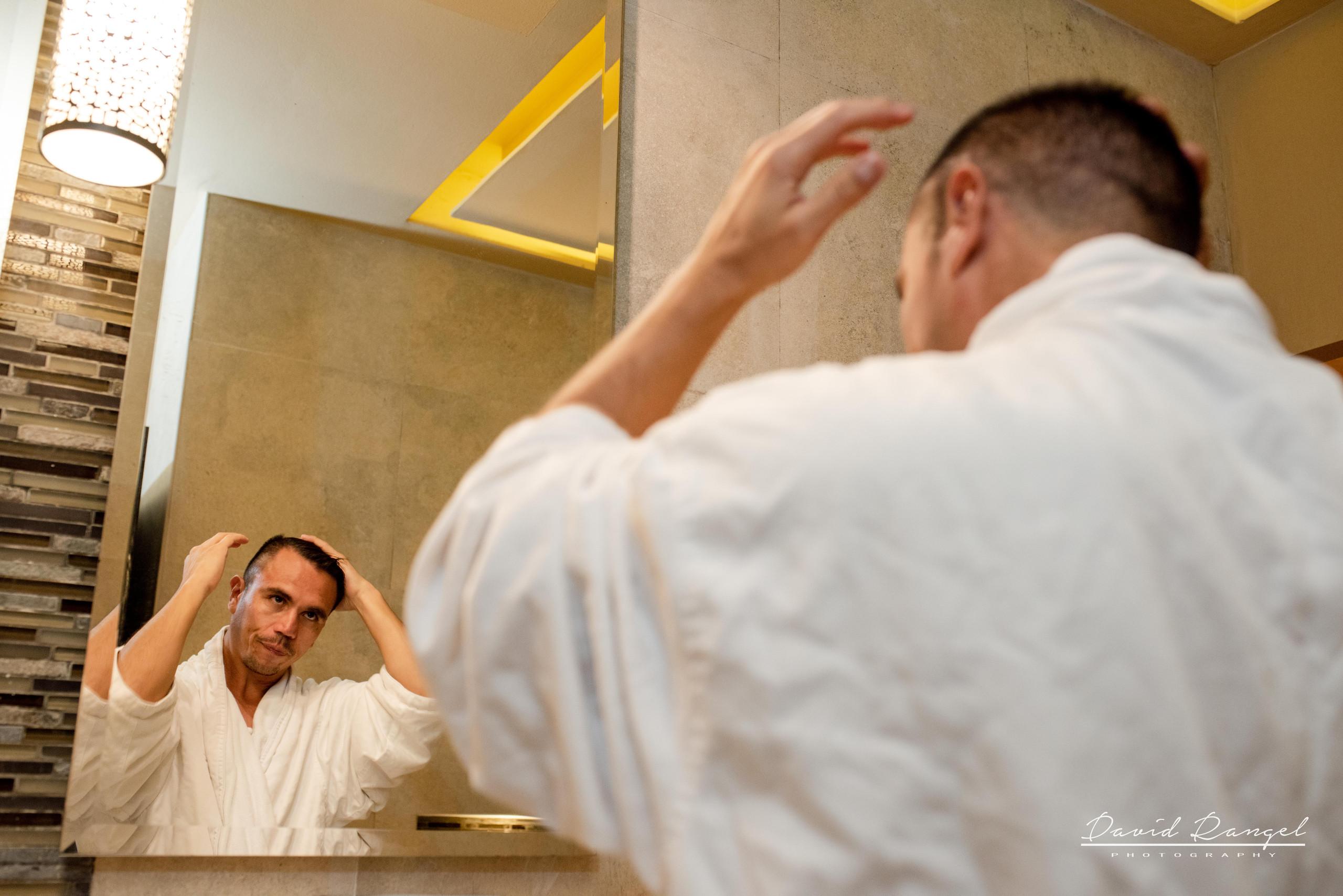 groom+getting+ready+bathroom
