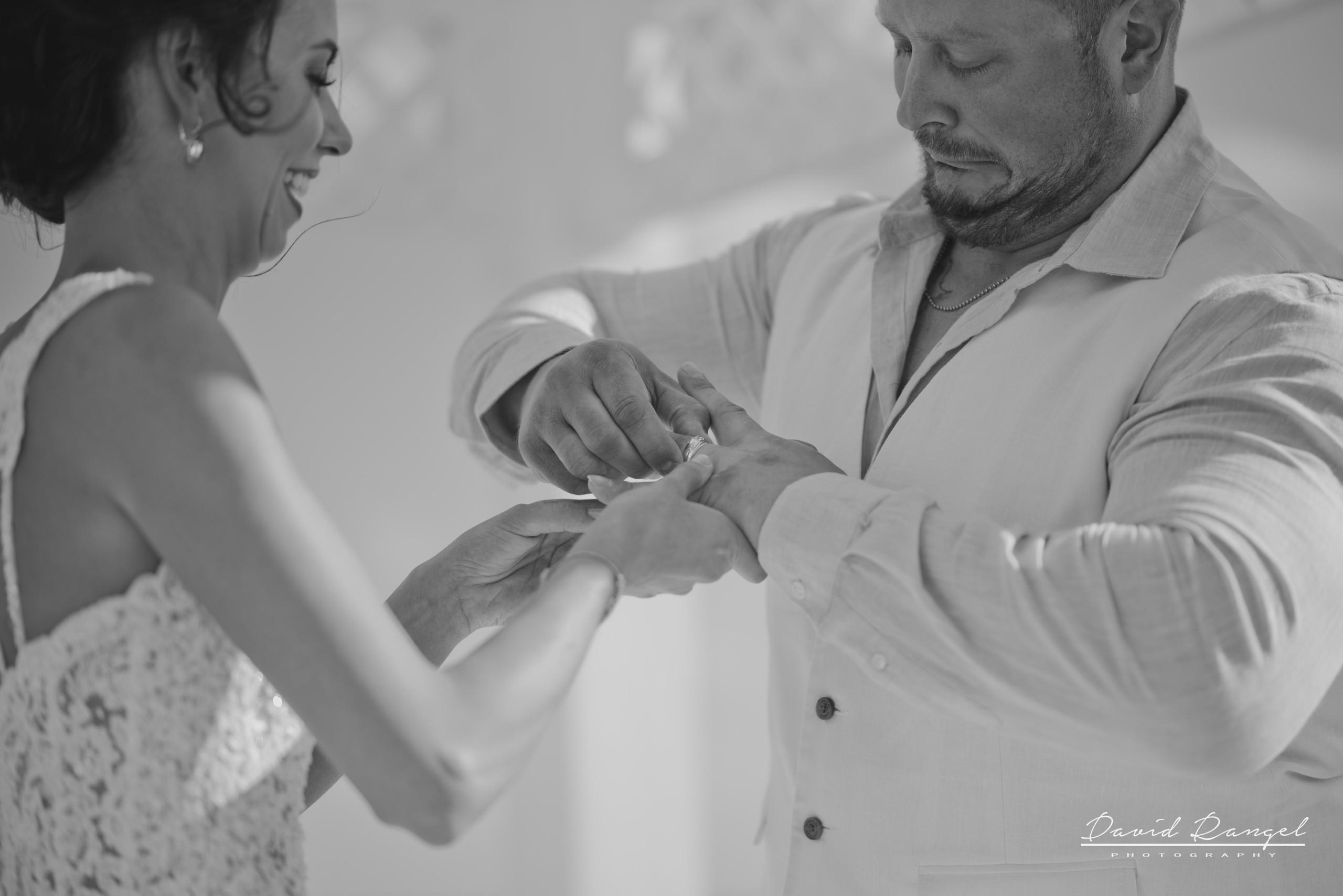 bride+groom+sky+deck+terrace+azul+beach+resort+photo+ceremony+gazebo+laughing+rings
