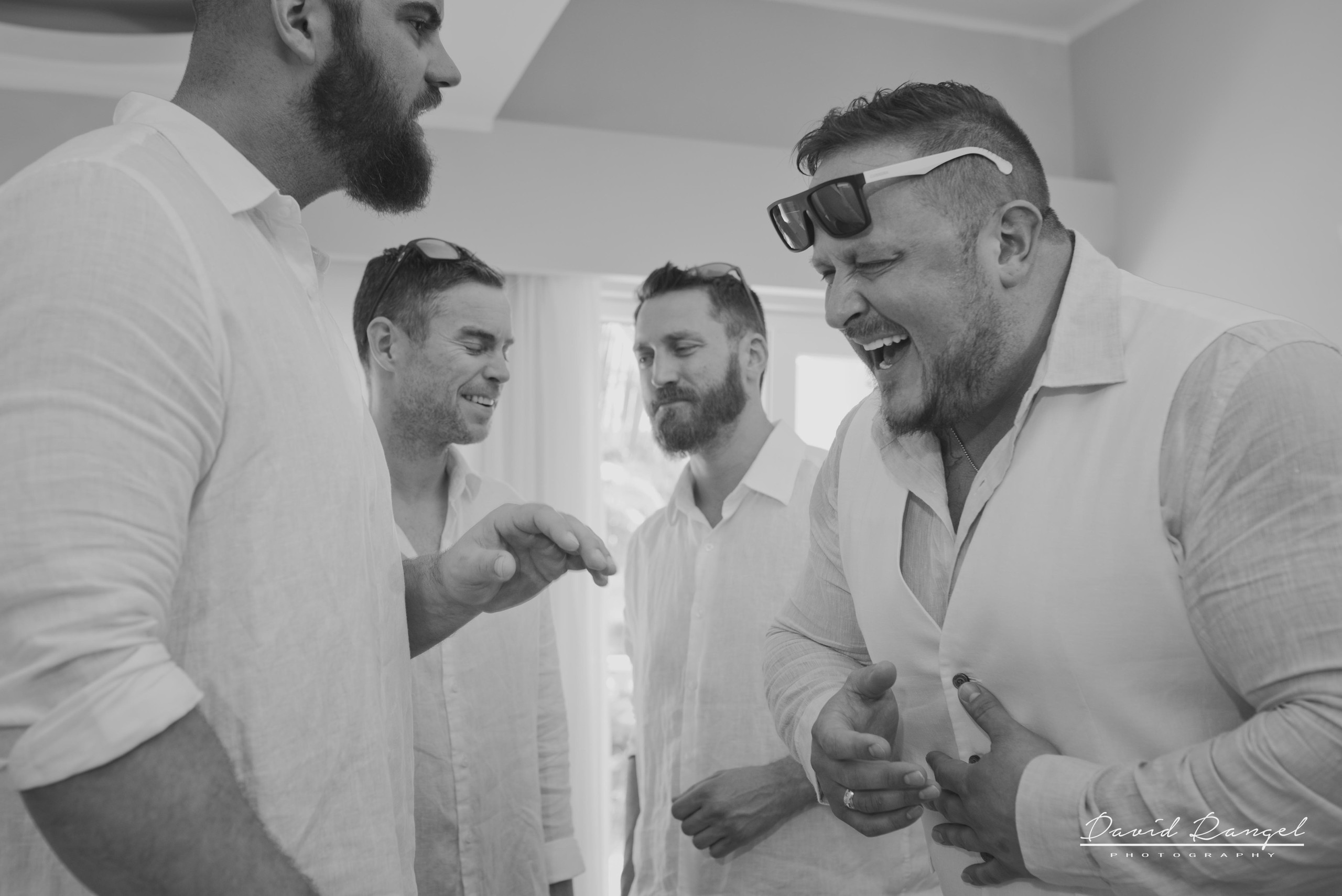 groom+crue+groomsmen+getting+ready+laughing
