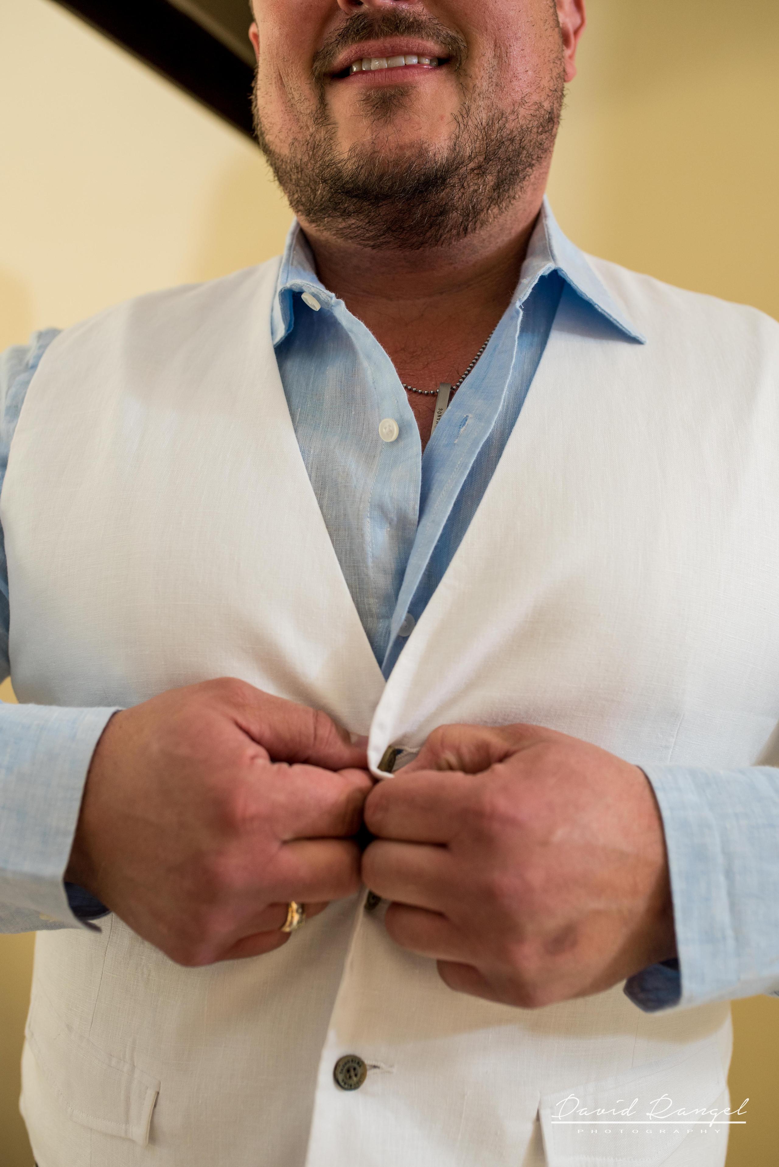 Groom+vest+botton+shirt+hands+photo