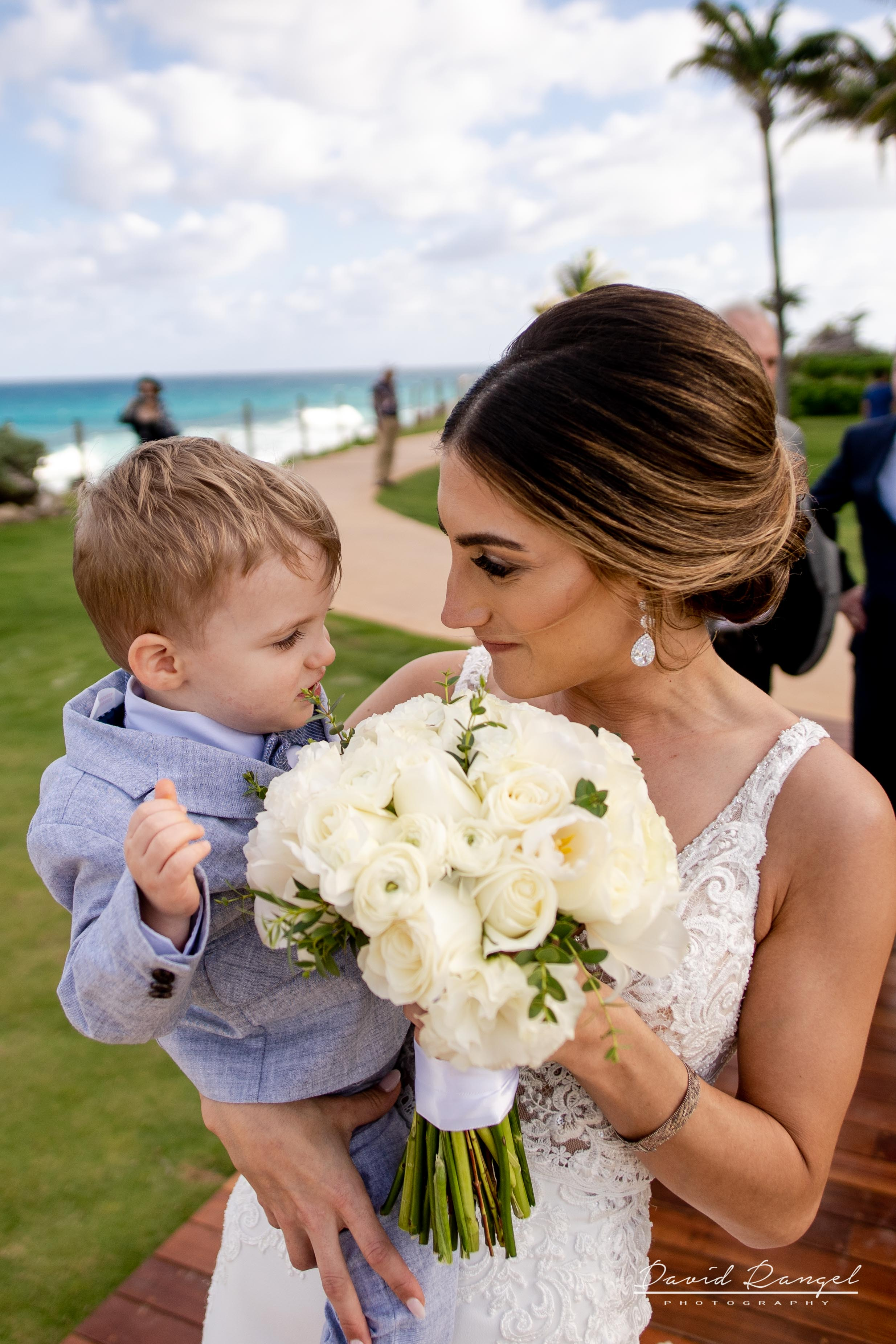 bride+son+happy+bouquet+flowers