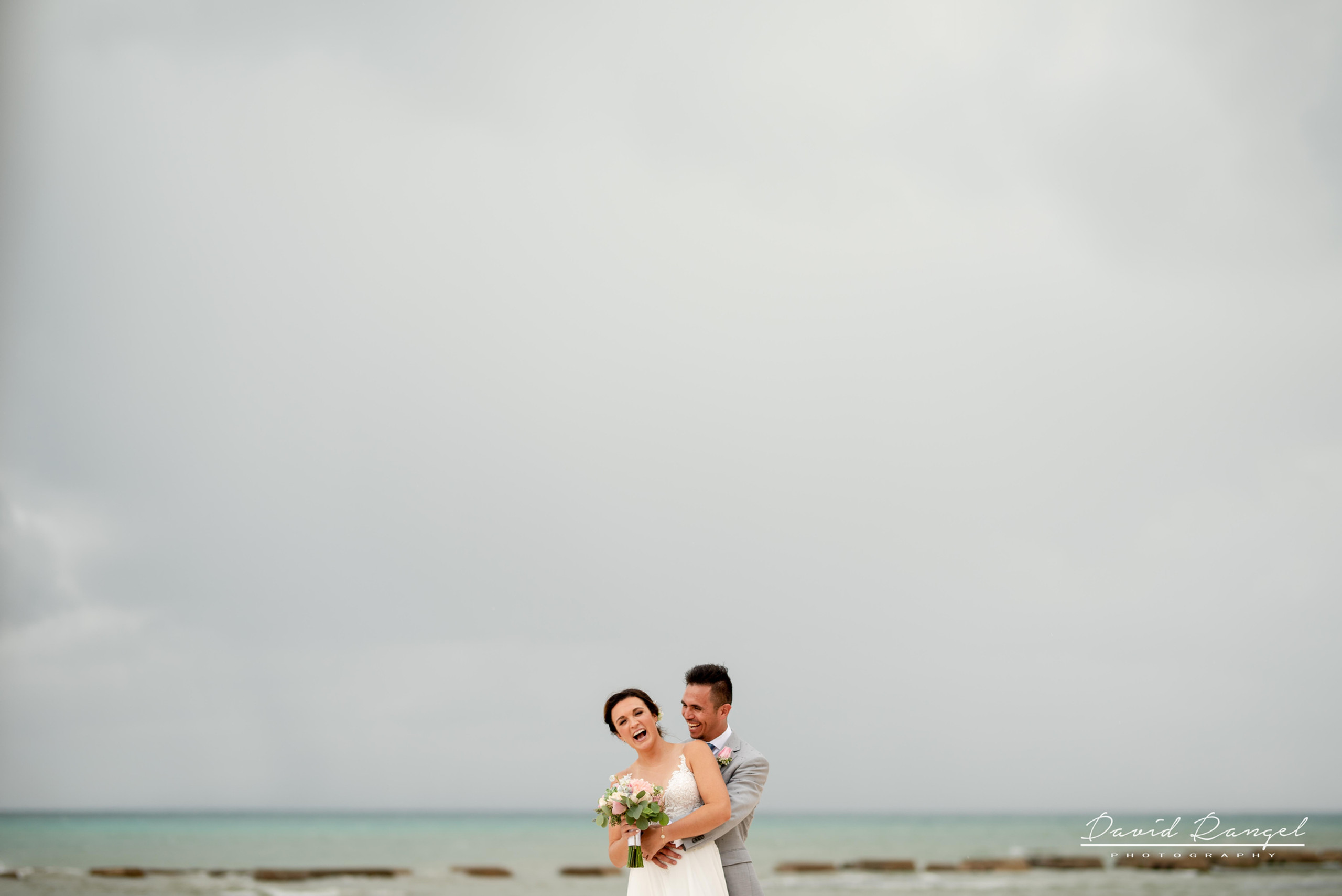 Beach+photo+session+couple+love+hugh+kiss+bride+groom